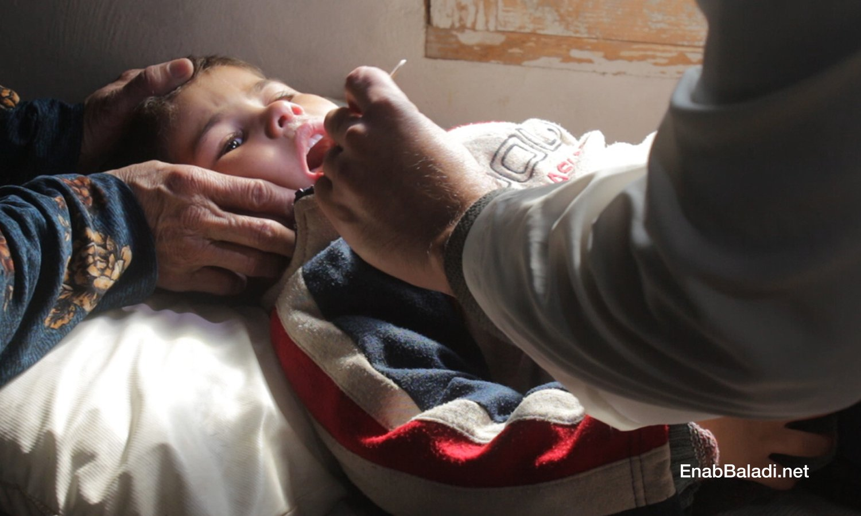 A male doctor examining a child in the health center of al-Fardan in the northern countryside of Idlib- February 2021 (Enab Baladi – Iyad Abdul Jawad))
