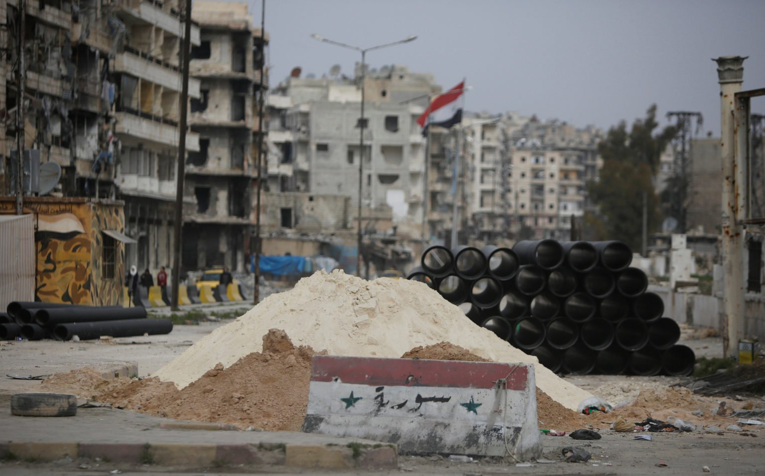 A checkpoint of the Syrian regime's forces in a neighborhood in Aleppo city — 8 February 2018 (Reuters)