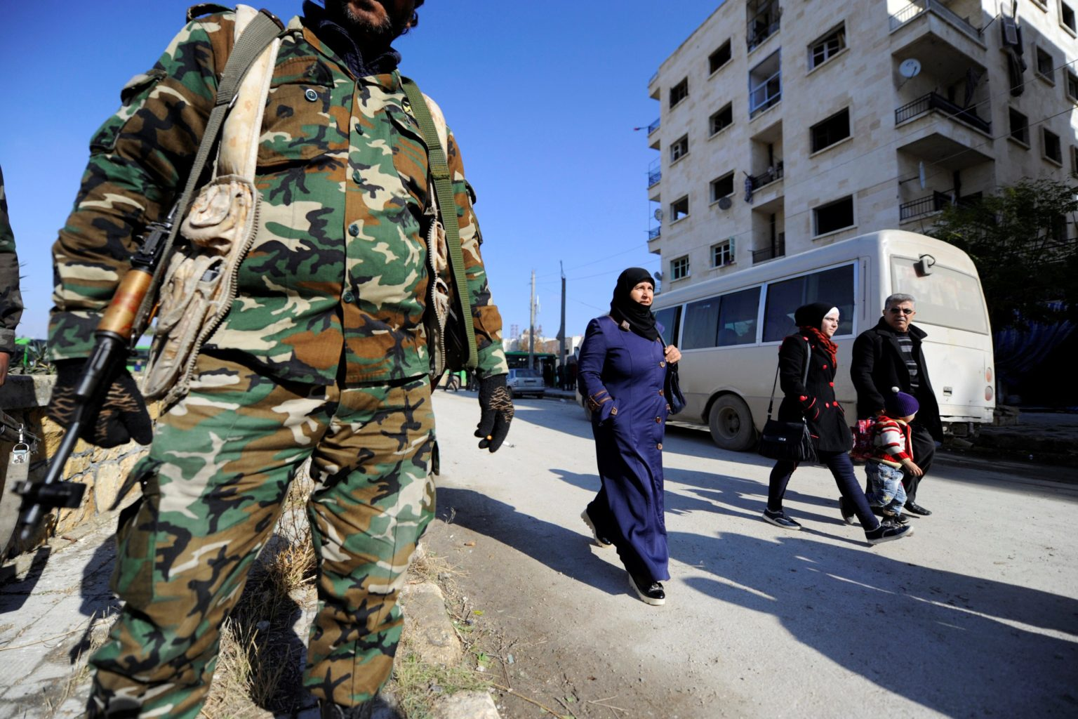 People heading to check on their houses in the Ibrahim Hananu neighborhood, Aleppo city, in the presence of Syrian regime's forces— 4 December 2016 (Omar Sanadiki)