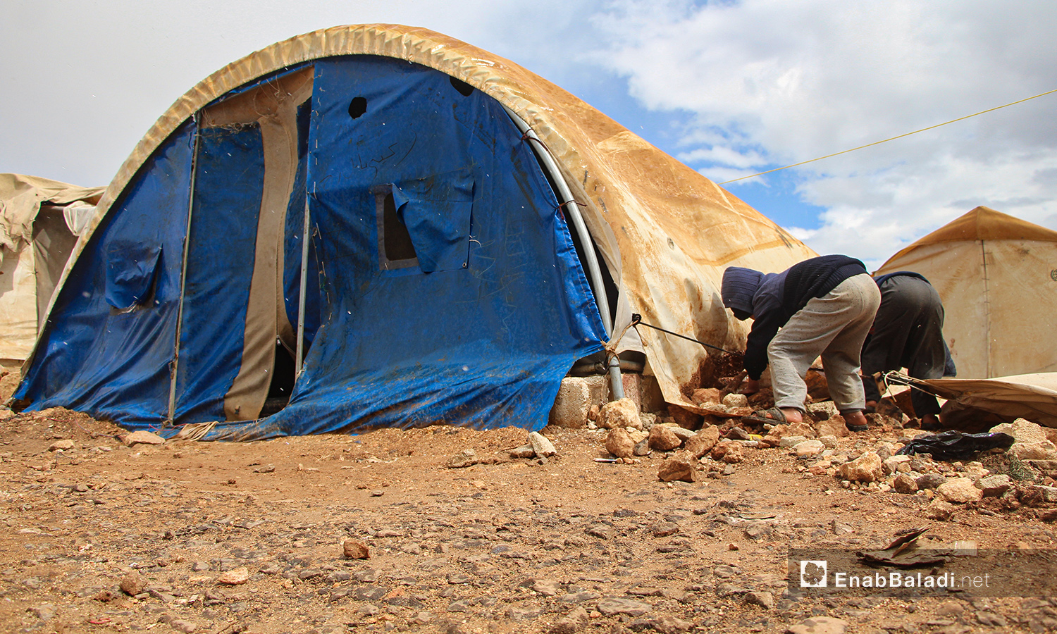 A storm with heavy rain hit the camps for internally displaced people (IDPs) in the northern countryside of Idlib, uprooting the already worn-out tents —24 March 2021 (Enab Baladi / Iyad Abdul Jawad)