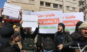 A protest in Idlib city in rejection of the Syrian Salvation Government's Awqaf Ministry's decision raising the rents of waqf shops - 06 March 2021 (Enab Baladi / Anas al-Khouli)
