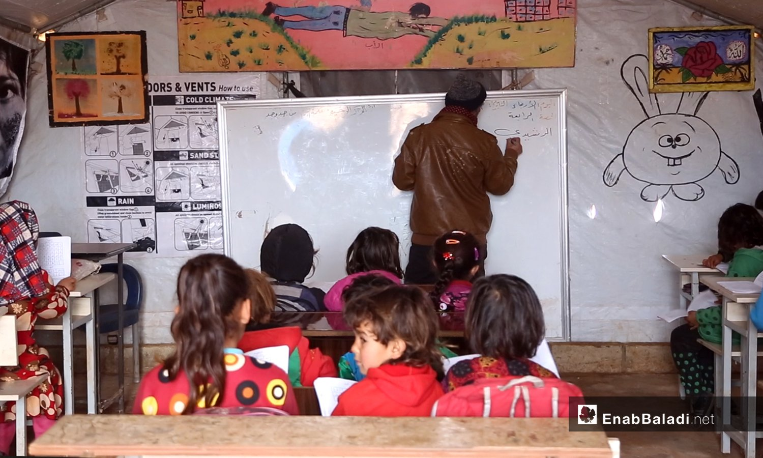 A volunteer teacher in one of northern Idlib countryside's displacement camps - February 2021 (Enab Baladi / Yousef Ghuraibi)