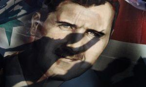 An expressive photo of the President of the Syrian regime Bashar al-Assad (AP)