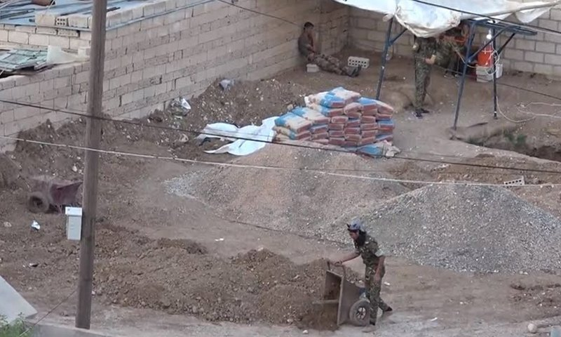 Elements of the Kurdish People's Protection Units (YPG) digging a tunnel in Amouda in al-Hasakah governorate - June 2018 (HR Monitor)