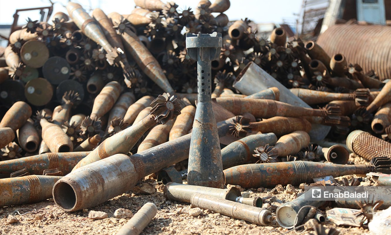 The remains of bad ammunition at the Idlib City Ammo Dump. Civilians tend to collect and sell abandoned ammunition and weapon parts —5 March 2021 (Enab Baladi/Yousef Ghuraibi)