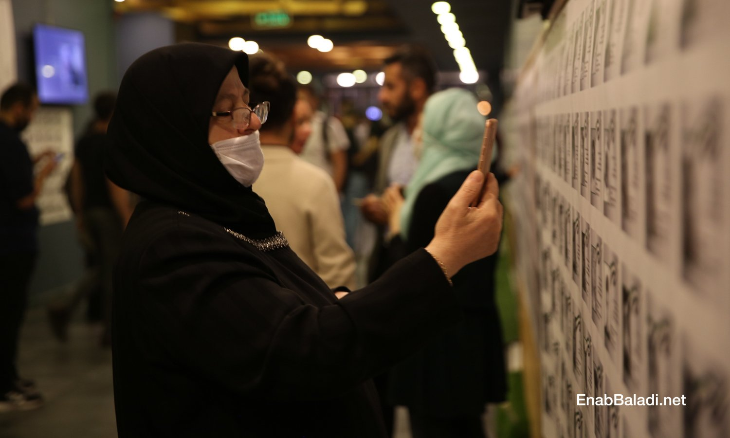 """The """"Residents of Memory"""" photo exhibition, displaying thousands of pictures of child victims killed after 2011, organized by the Syrian activist Tamer Turkmane in Istanbul – 13 October 2020 (Enab Baladi/Abdulmuin Humus)."""