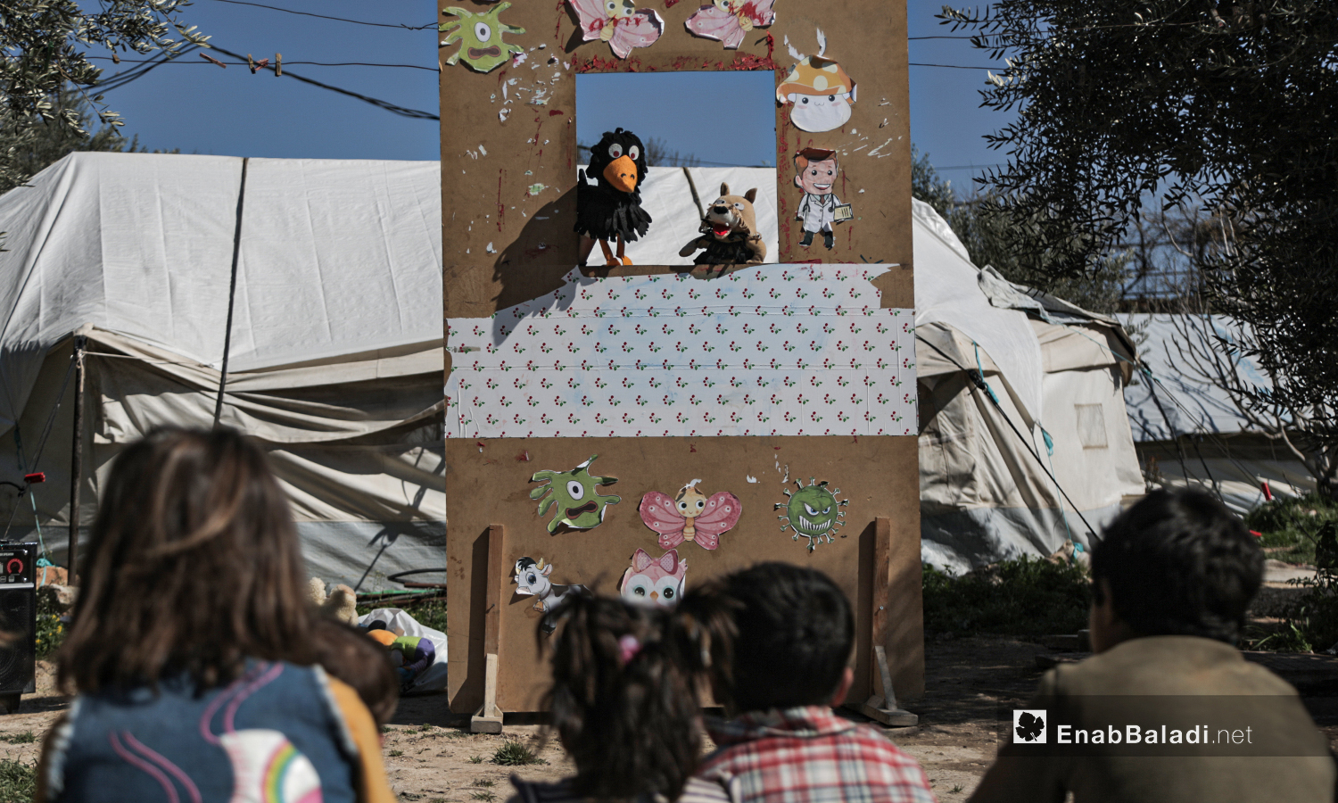 A puppet show staged by al-Harah theater group in one of the camps for internally displaced people (IDPs) near Idlib city - 28 March 2021 (Enab Baladi / Yousef Ghuraibi)