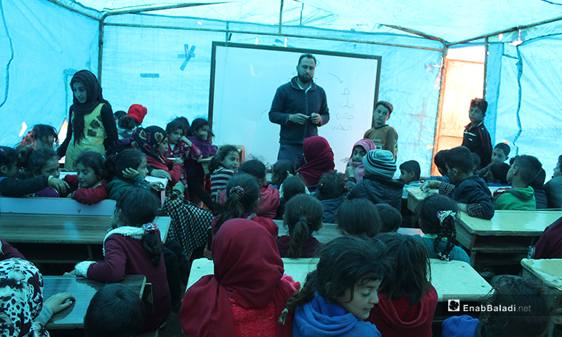 150students in a worn-out tent made into a classroom in a camp east of KafrArrouqvillage, north of Idlib— 12 March 2020 (EnabBaladi)