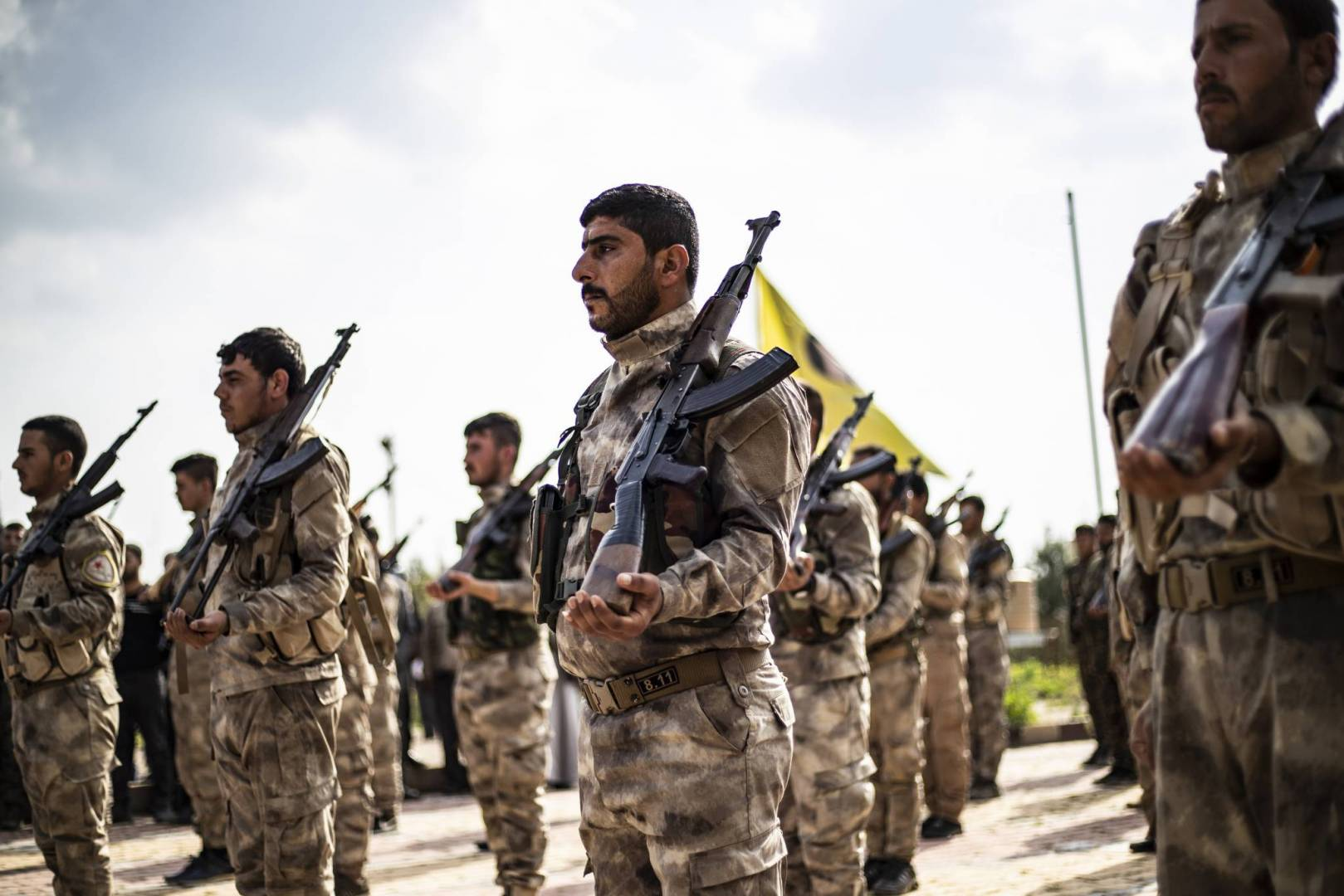 Fighters of the Syrian Democratic Forces (SDF) during a funeral procession of a fighter killed in Deir ez-Zor – April 2019 (AFP)