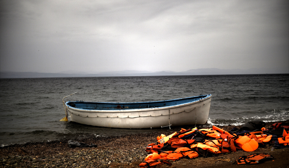 A boat left by refugees near the shores of the Greek island of Lesbos – 8 October 2015 (AFP)