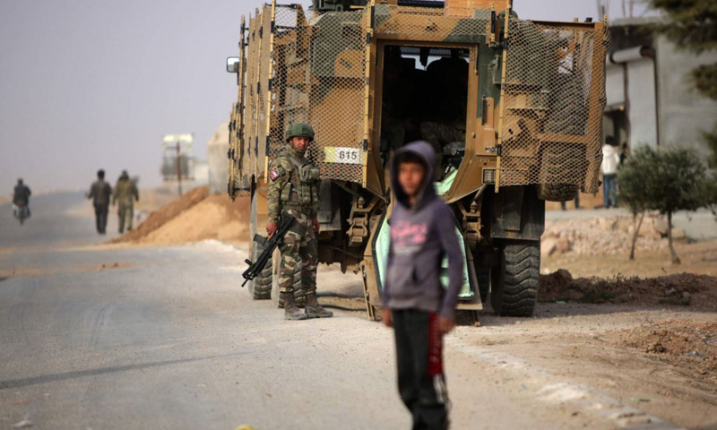 Russian troops in the SDF-held areas (AFP)