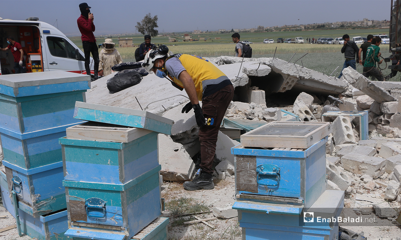 A civil defense volunteer checking the explosion site - 03 May 2021 (Anas al-Khouli / Enab Baladi)