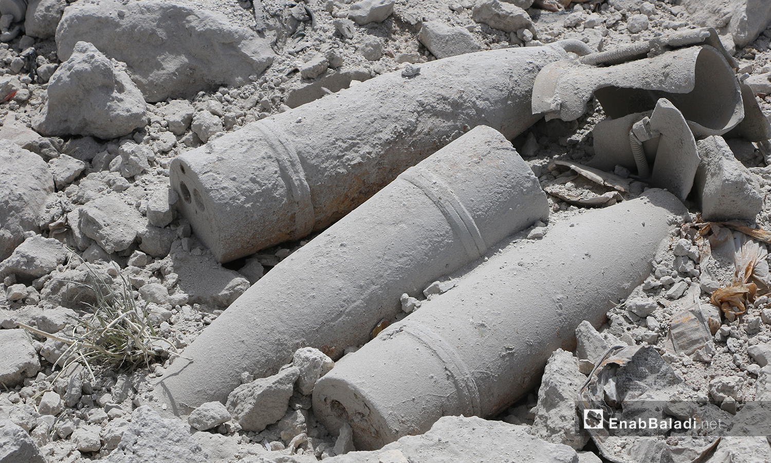 Remnants of artillery shells in the weapons warehouse blast site - 03 May 2021 (Anas al-Khouli / Enab Baladi)