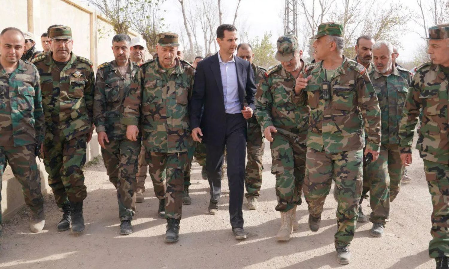 Head of the Syrian regime Bashar al-Assad visiting forces in rural Damascus -18 March 2018 (SANA)