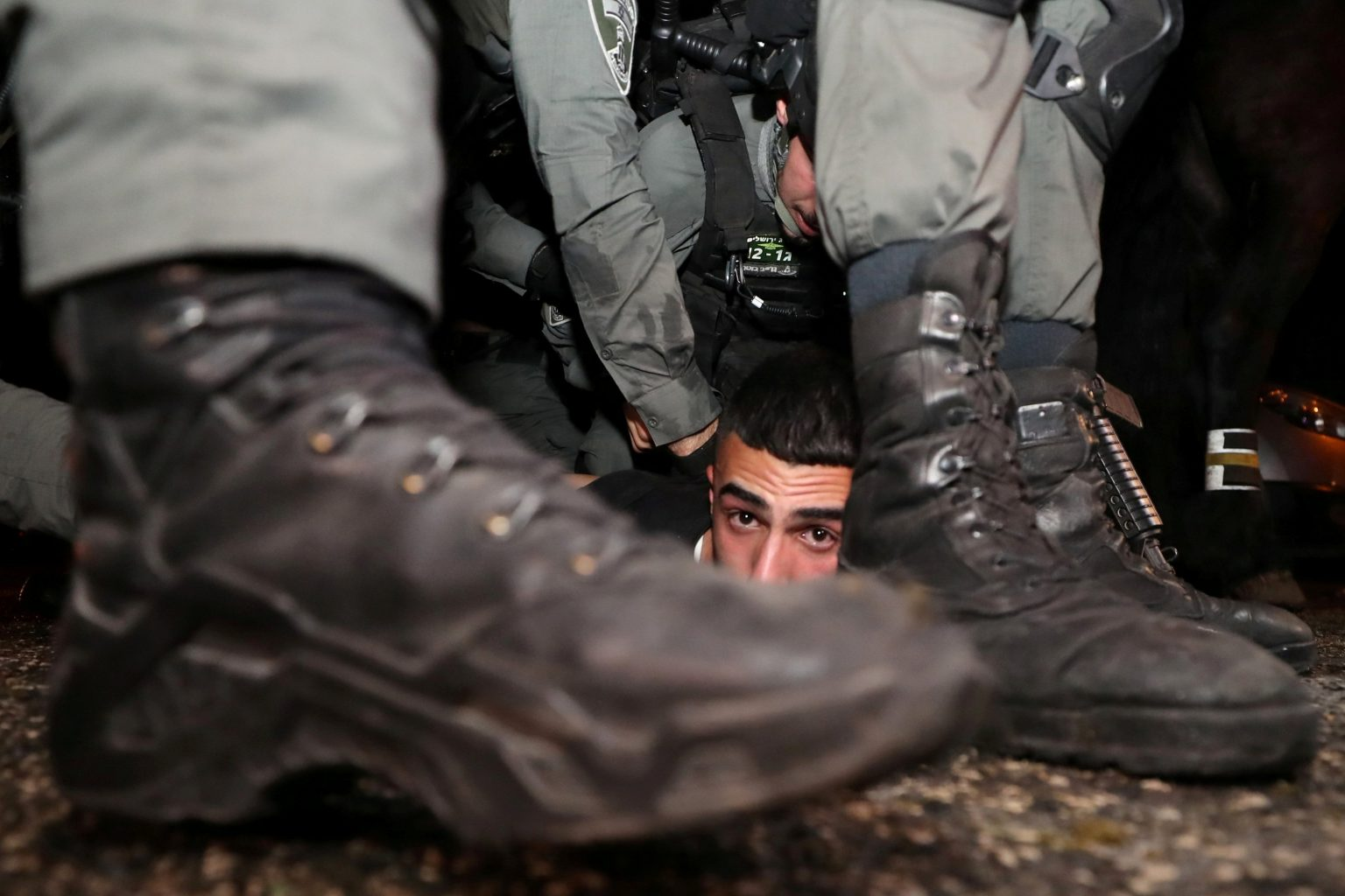 Israeli police arresting a Palestinian protestor amidst heated clashes over property rights between Palestinians and Israeli settlers in Sheikh Jarrah in East Jerusalem – 5 May 2021 (Reuters)