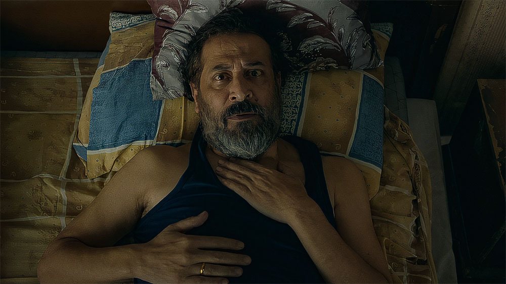 Syrian actor Abdel Moneim Amiry in a scene from Anonymous Entry - 2021