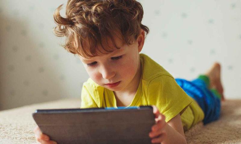 A child playing on an iPad (CNN)