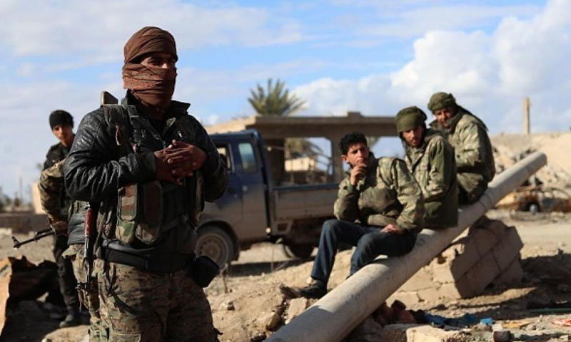 Fighters from the Syrian Democratic Forces (SDF) stationed in al-Baghouz town in Deir Ezzor governorate (AFP)