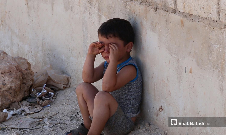 A child crying in one of the IDPs camps in northern Syria (Enab Baladi/Iyad Abu al-Joud)