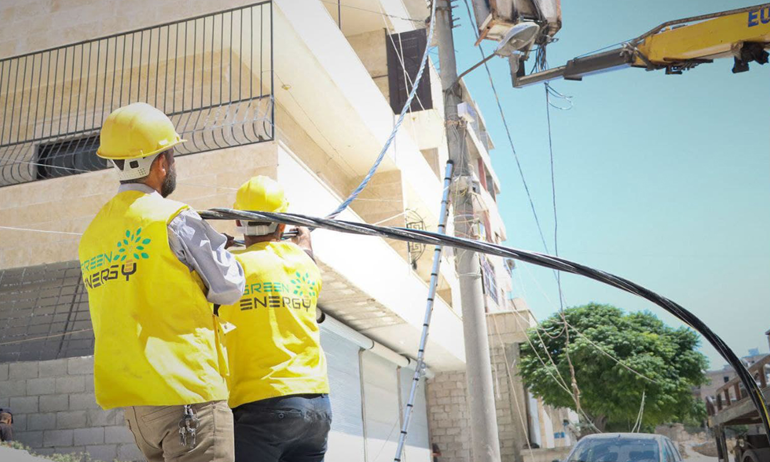 Green Energy workers connecting electrical networks in the city of Salqin, north of Idlib- 17 June 2021 (Green Energy)