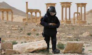 Russian explosives specialist clearing mines from the ancient city of Palmyra in Syria (Reuters)