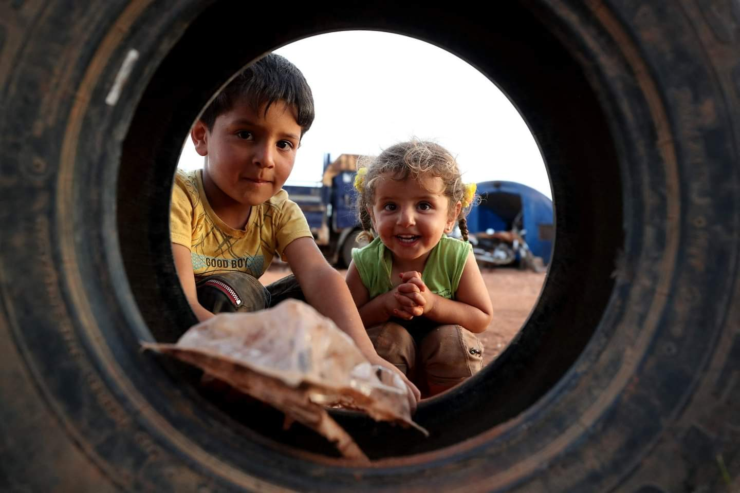 Syrian children playing in the IDPs camp in the city of Ma'arrat Misrin, in Idlib province, northwestern Syria— 8 May 2021 (AFP/ Omar Haj Qadour)