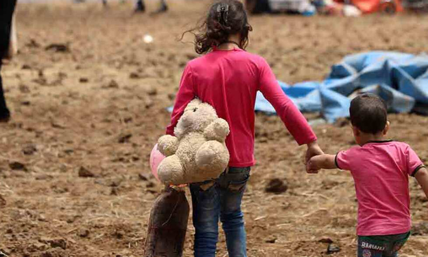 Syrian little girl displaced from Daraa province holding a stuffed toy near the Occupied Golan, in Quneitra province – 29 June 2018 (Reuters)
