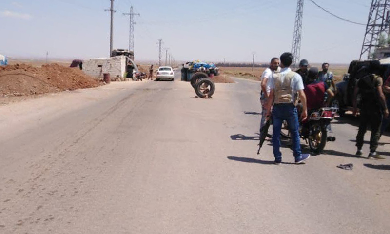 Anti-regime local fighters in control of one of the Syrian regime forces' checkpoints in al-Sahwa town, east of Daraa — 29 July 2021 (Local sources)