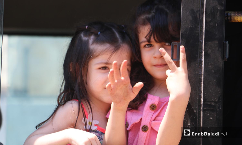 Syrian refugees heading back home through the Bab al-Hawa border crossing on the Syrian-Turkish border to spend the Eid al-Adha holiday in northwestern Syria - 6 July 2021 (Enab Baladi/Iyad Abdul Jawad)