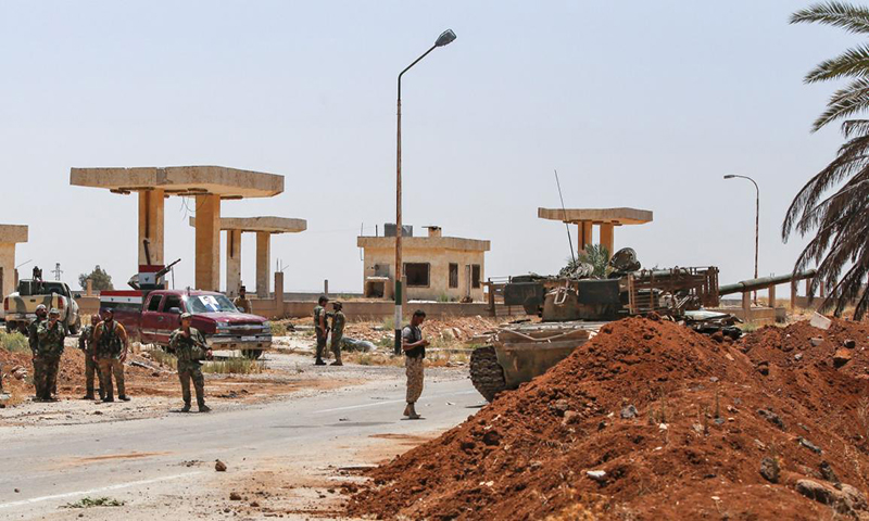 Clashes between Syrian regime forces and former armed opposition fighters in the al-Sanamayn city in Daraa governorate, south of Syria — April 2020 (AFP)