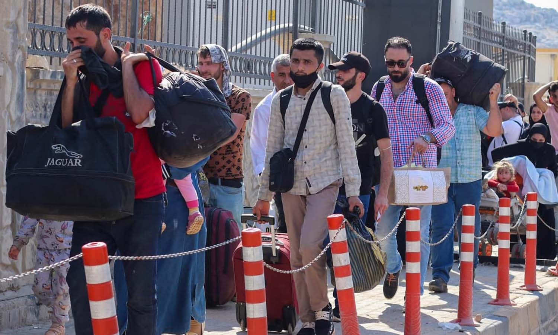 Syrians at the Bab al-Hawa Border Crossing during the Eid al-Adha visit - 18 July 2021 (Bab al-Hawa Border Crossing)