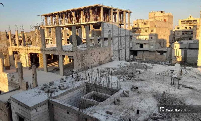 Unfinished multi-story buildings in Raqqa city, northeast Syria - 6 July 2021 (Enab Baladi / Hussam al-Omar)