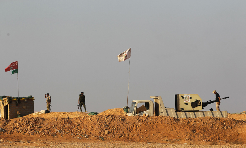 Elements of the Popular Mobilization Forces (PMF) on the Syrian-Turkish borders (AFP)