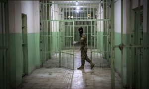 A member of the Syrian Democratic Forces (SDF) serving guard in a prison in al-Hasakah province in northeastern Syria — 29 October 2021 (AFP)