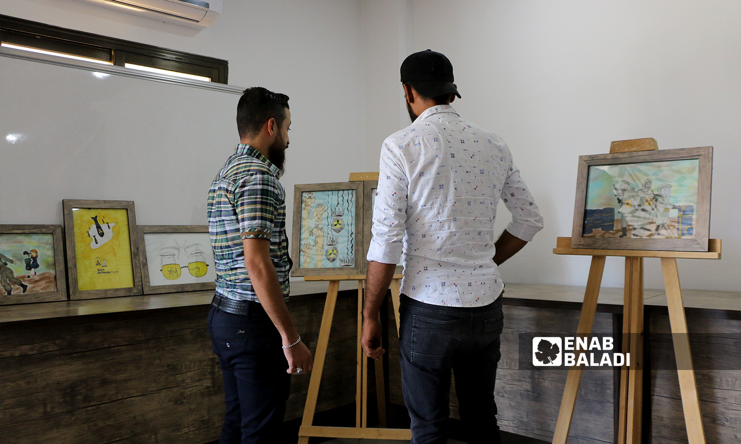 """An art exhibition under the slogan """"Do Not Suffocate Truth"""" was held in Azaz city in Aleppo governorate in remembrance of the Eastern Ghouta's chemical massacre - 21 August 2021 (Enab Baladi / Walid Othman)"""