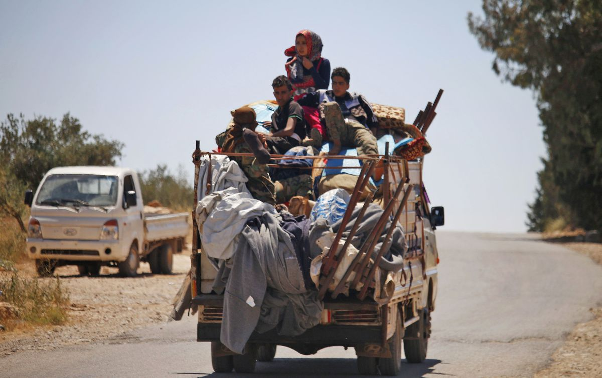 Syrians escaping the clashes in Daraa city — 27 July 2018 (AFP-Muhammad Abazaid)