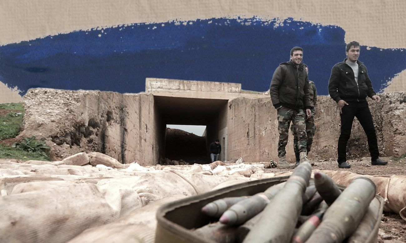 Syrian regime forces standing next to fragments of ammo and explosive devises in Daraa city, south of Syria — February 2019 (AFP/Edited by Enab Baladi)