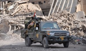 A military vehicle transporting Syrian regime forces in Daraa (AFP)