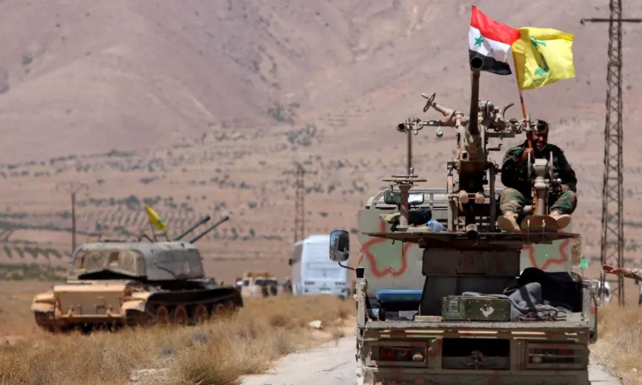 Syrian regime forces and the Hezbollah militia in al-Bukamal city (Reuters)
