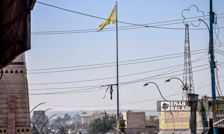 The flag of Raqqa's Military Council raised in the city of Raqqa - 22 August 2021 (Enab Baladi / Hussam al-Omar)