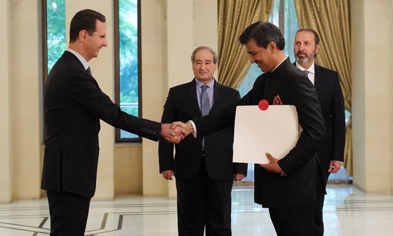 The head of the Syrian regime, Bashar al-Assad, accepting the credentials of the new Indian Ambassador to Syria, Mahender Singh Kanyal, in Syria's People's Assembly - 26 August 2021 (SANA)