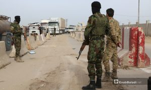 Members of the Turkish-backed Syrian National Army at a checkpoint placed at the eastern entrance of Azaz city in the northern countryside of Aleppo- 17 April 2021 (Enab Baladi- Walid Othman)