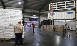 Workers at the World Food Programme (WFP) loading trucks with relief assistance to be delivered from regime areas to northwestern Syria - 30 August 2021 (Twitter)