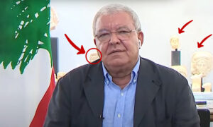 Looted Syrian artifacts displayed in the background of Lebanese PM, Nohad Machnouk during a remote interview with Al-Jadeed TV (Edited by Enab Baladi)