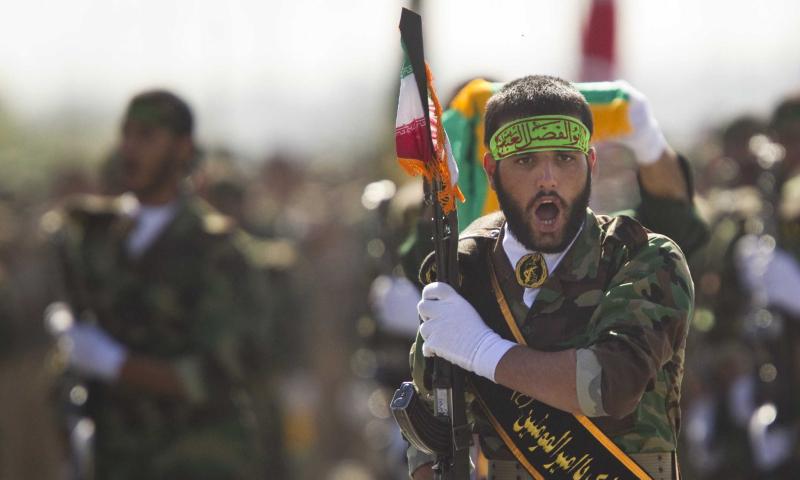 An Iranian militia member at a military parade (Reuters)