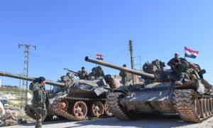 Syrian regime's soldiers and tanks in Idlib countryside - 2021 (al-Watan newspaper)